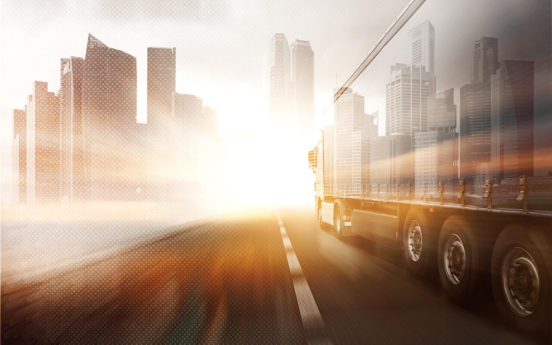 Bakgrundsbilder Lastbilar Väg går automobil byggnader 1920x1200 lastbil vägar Rörelse bil Bilar Hus byggnad