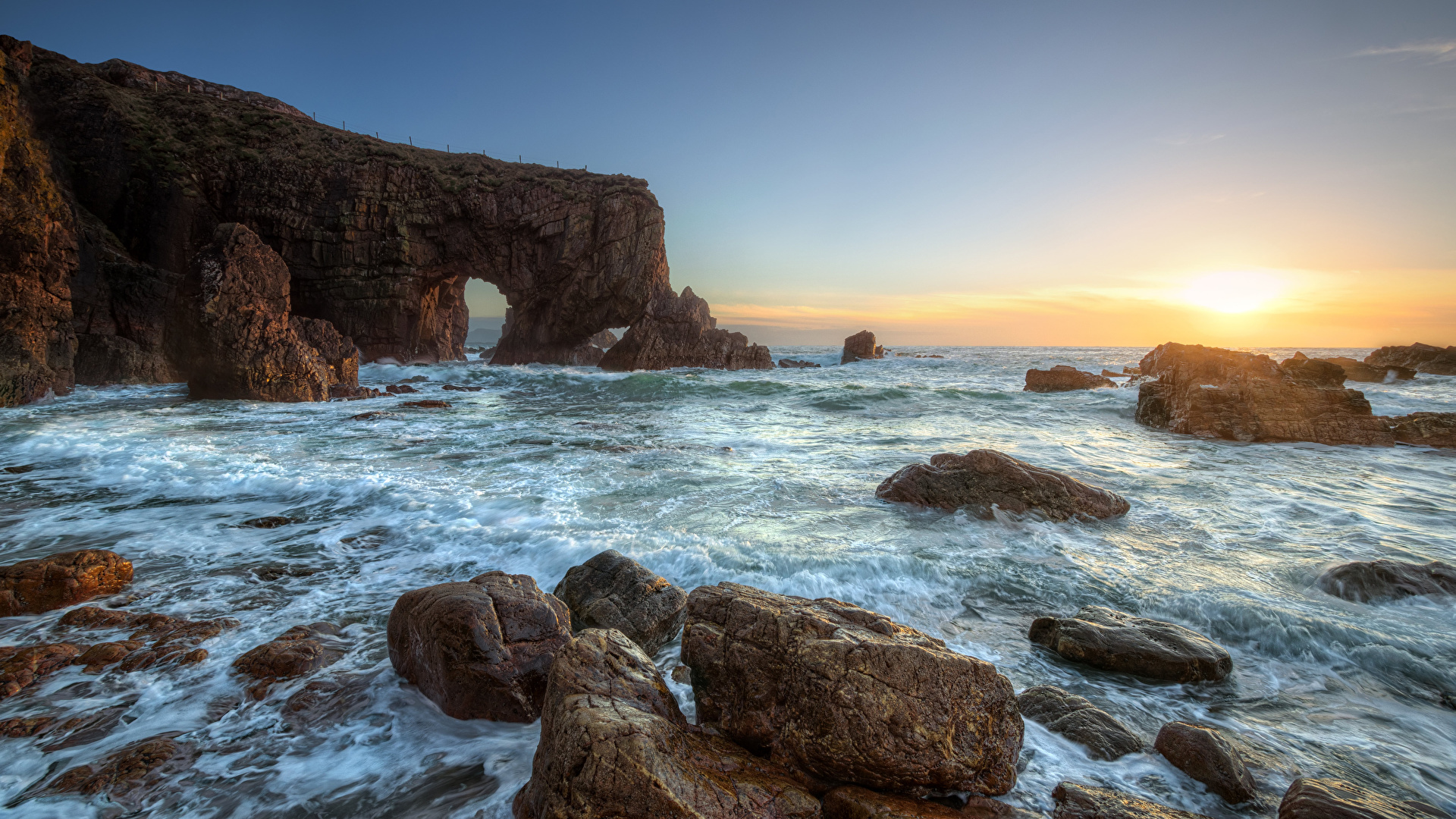 Picture Ireland Sea Arch Stack, Donegal Crag Nature Sunrises and sunsets Coast Stones 1920x1080 Rock Cliff sunrise and sunset stone