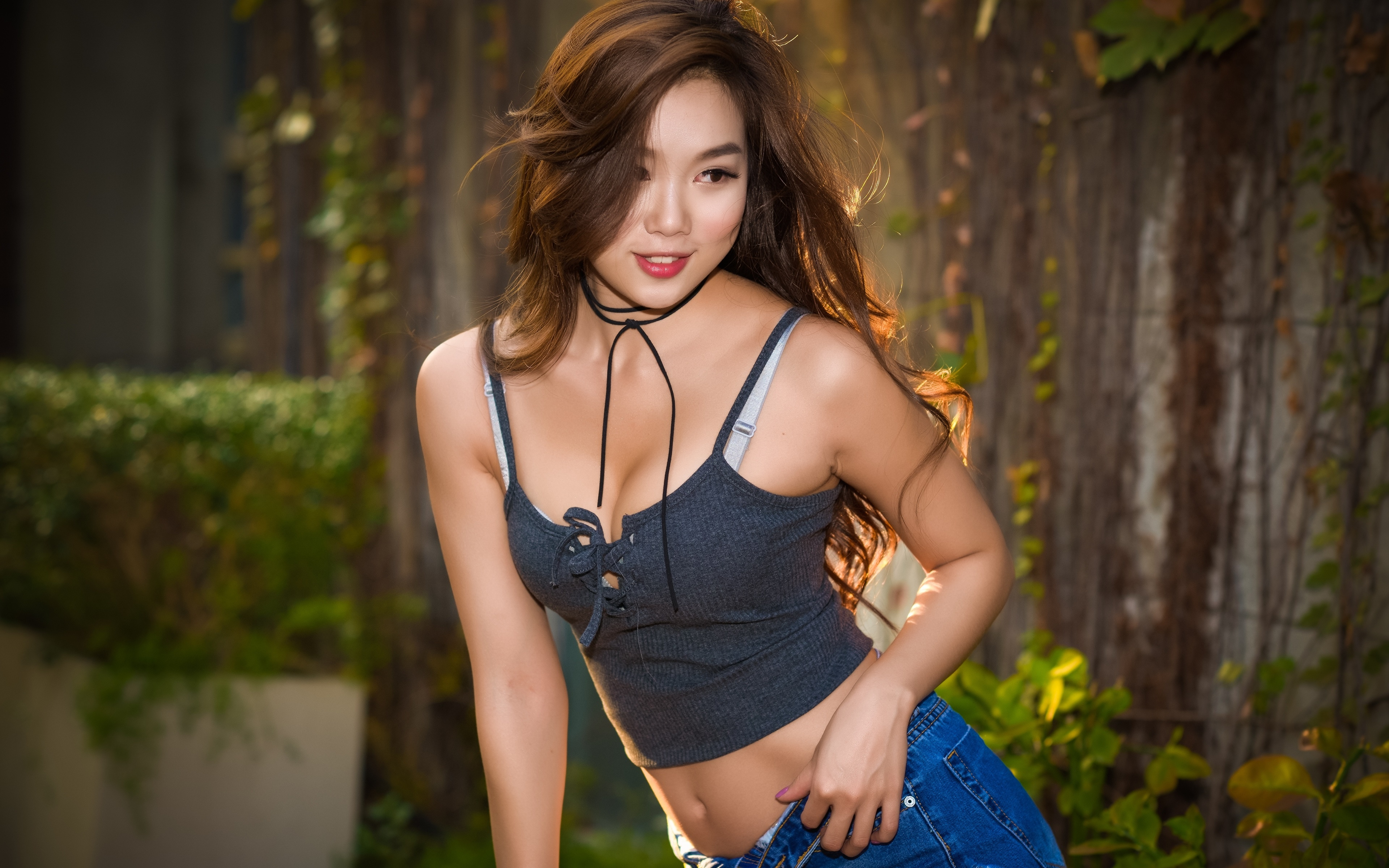 Picture Brown haired blurred background Girls Asiatic Hands Glance 3840x2400 Bokeh female young woman Asian Staring