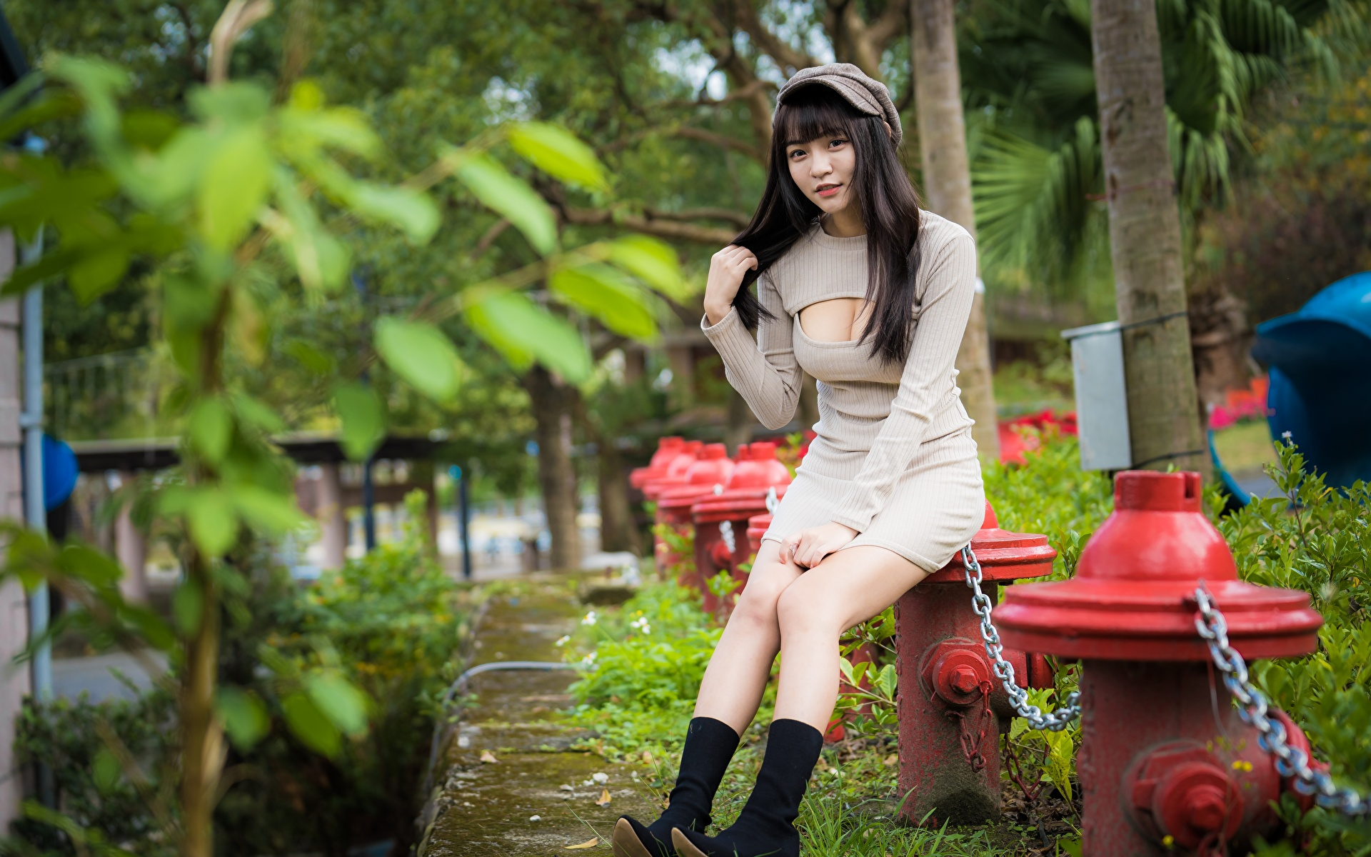 Pictures Brunette girl Wearing boots Décolletage Girls Legs Asian Chain sit Hands Baseball cap Dress 1920x1200 neckline decollete female young woman Asiatic Sitting gown frock