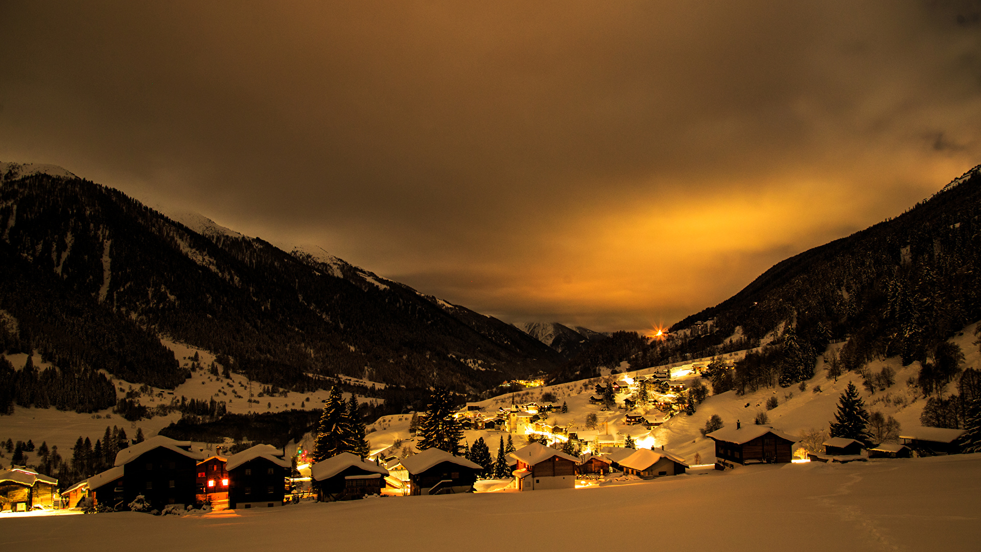 Pictures Switzerland Grafschaft Goms Winter Mountains Snow night time Street lights Houses Cities 1920x1080 mountain Night Building