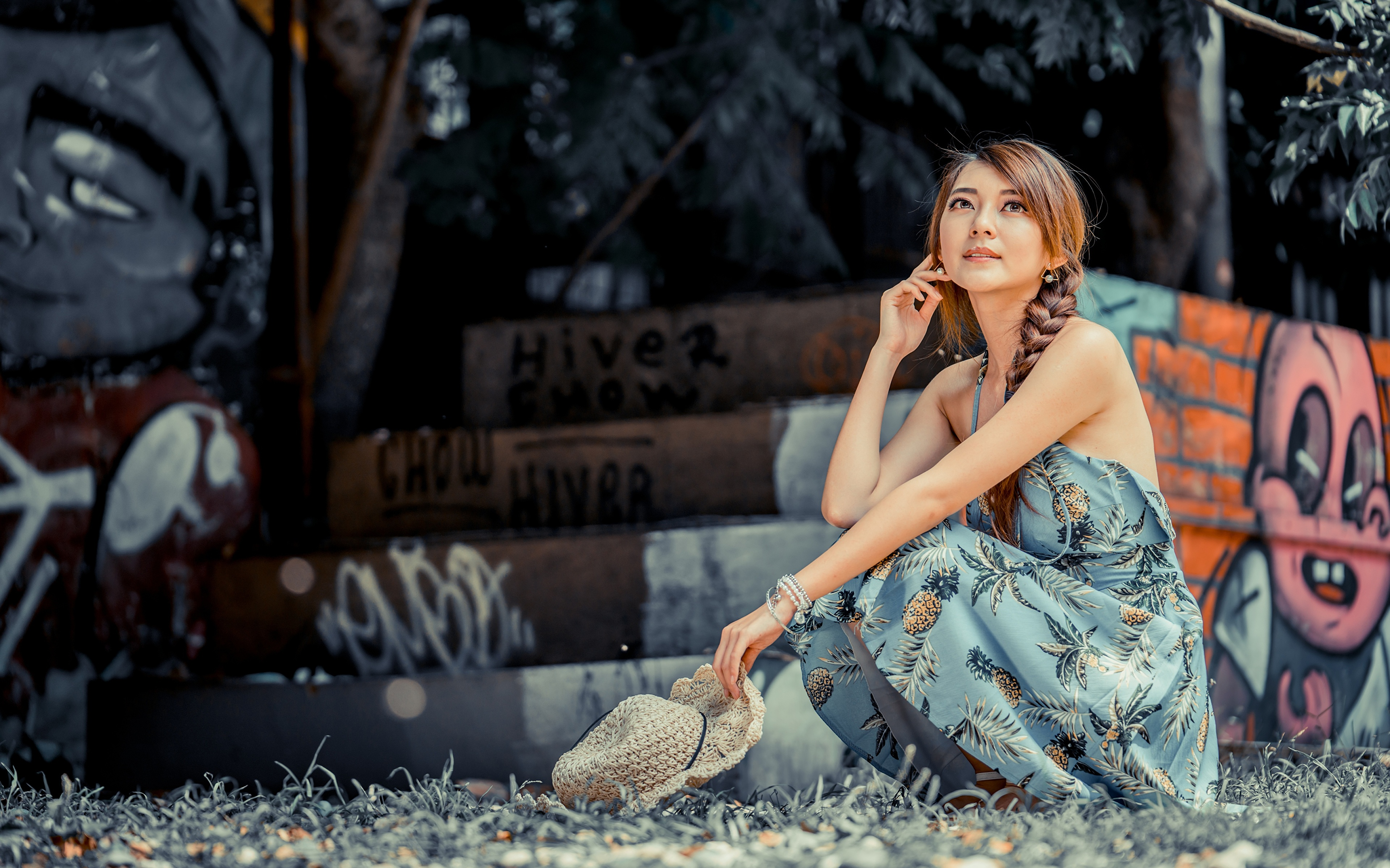 Photos Brown haired Bokeh Hat Girls Asiatic sit Hands frock 3840x2400 blurred background female young woman Asian Sitting gown Dress