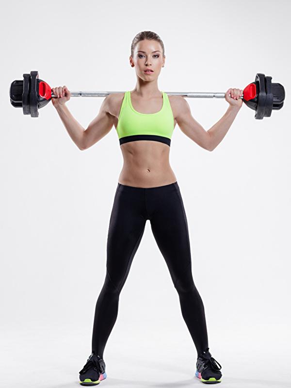 Foto Fitness Sport Mädchens Hantelstange Bauch Grauer Hintergrund 600x800