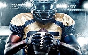 Bilder American Football Mann Hand Handschuh Ball Helm Sport