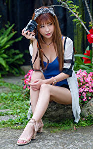 Images Asiatic Brown haired Sit Legs Camera young woman