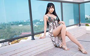 Desktop wallpapers Asiatic Brunette girl Sit Dress Legs Glance Beautiful Girls