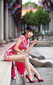 Wallpapers Asiatic Dress Sitting Legs High heels Staring Beautiful Girls