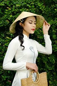 Fotos Asiatisches Handtasche Brünette Der Hut Hand