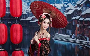 Bilder Asiaten Regenschirm Brünette Starren Lächeln Schminke Japanese junge frau