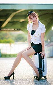 Wallpapers Asian Posing Sit Suitcase High heels Legs Beautiful Skirt Blouse Uniform Stewardesses Brown haired young woman