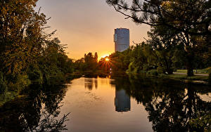 Bilder Österreich Wien Park Morgendämmerung und Sonnenuntergang Teich Lichtstrahl Bäume Wasserpark Floridsdorf