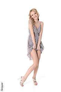 Images Belle Claire iStripper White background Blonde girl Posing Smile Frock Hands Legs Stilettos young woman