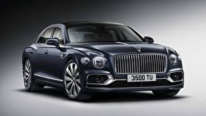 Fotos Bentley Luxus Schwarz Vorne Grauer Hintergrund Flying Spur, 2019 automobil Autos