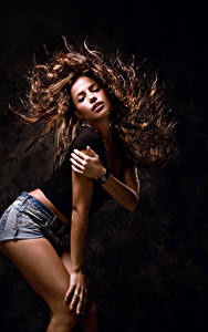 Image Black background Brown haired Hair Dancing Hands young woman
