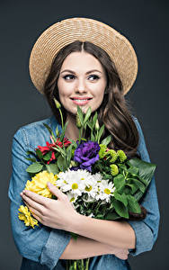Wallpapers Bouquets Gray background Brown haired Hat Hands Smile young woman