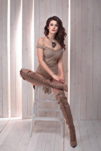Pictures Brown haired Sitting Wearing boots Girls