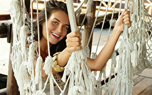Pictures Brown haired Smile Hands Staring Hammock young woman