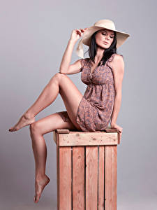 Wallpapers Brunette girl Gown Beautiful Legs Pose Sit Hat Girls