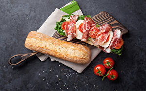 Bilder Butterbrot Brot Schinken Tomate Sandwich Schneidebrett Lebensmittel