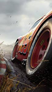 Bilder Cars 3 Nahaufnahme Rot Räder Lightning McQueen Zeichentrickfilm