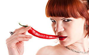 Wallpapers Chili pepper Fingers White background Redhead girl Glance Face young woman