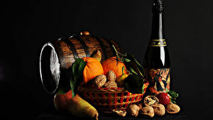 Wallpaper New year Cask Sparkling wine Nuts Pears Orange fruit Black background Bottles
