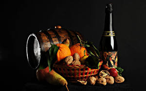 Wallpaper New year Cask Sparkling wine Nuts Pears Orange fruit Black background Bottles