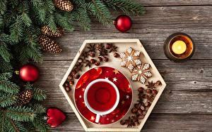 Bilder Neujahr Kerzen Tee Kekse Haselnuss Ast Zapfen Kugeln Tasse