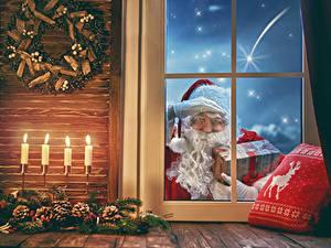 Bilder Neujahr Kerzen Fenster Zapfen Weihnachtsmann Geschenke