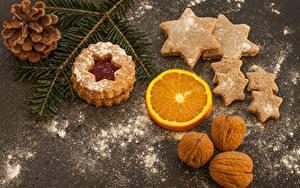 Bilder Neujahr Kekse Nussfrüchte Puderzucker Zapfen Stern-Dekoration Ast Lebensmittel