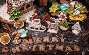 Bilder Neujahr Kekse Puderzucker Bretter Text Englischer Design Lebensmittel