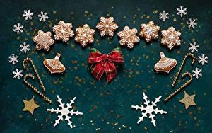 Hintergrundbilder Neujahr Kekse Schneeflocken Schleife