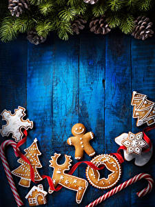 Pictures New year Cookies Sweets Deer Wood planks Wall Conifer cone Design Christmas tree Food