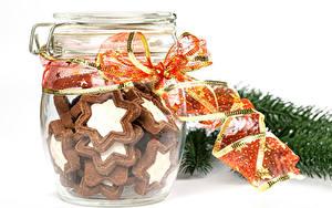 Fotos Neujahr Kekse Weißer hintergrund Einweckglas Band Lebensmittel