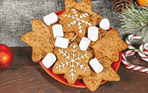 Bilder Neujahr Kekse Bretter Marshmallow Schneeflocken Lebensmittel