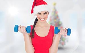 Bilder Neujahr Fitness Bokeh Mütze Blick Lächeln Hand Hantel Mädchens
