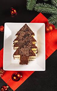 Bilder Neujahr Törtchen Schokolade Grauer Hintergrund Design Christbaum Kugeln Ast das Essen