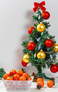 Hintergrundbilder Neujahr Mandarine Weihnachtsbaum Kugeln Zapfen Schleife Lebensmittel