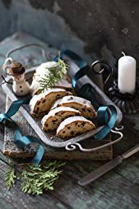 Fotos Neujahr Keks Kerzen Rosinen Schneemänner Lebensmittel