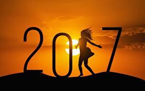 Fotos Neujahr Sonnenaufgänge und Sonnenuntergänge 2017 Sonne Silhouette Mädchens