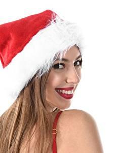 Fotos Neujahr Weißer hintergrund Mütze Braune Haare Starren Lächeln junge frau