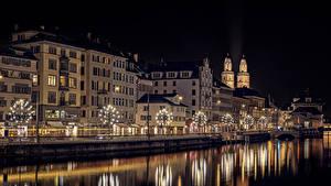Bilder Neujahr Zürich Schweiz Flusse Gebäude Nacht Lichterkette Stadtstraße