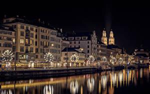 Bilder Neujahr Zürich Schweiz Flusse Gebäude Nacht Lichterkette Stadtstraße Städte