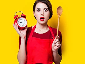 Wallpapers Clock Alarm clock Colored background Brown haired Surprise emotion Spoon female