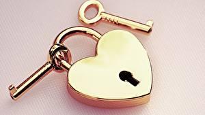 Wallpaper Closeup Colored background Key lock Padlocks Gold color