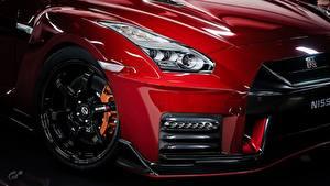 Hintergrundbilder Großansicht Nissan Metallisch Räder Fahrzeugscheinwerfer Rot GTR Nismo Gran Turismo Autos