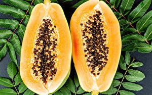 Фотографии Вблизи Листва Кусочки Двое papaya Пища