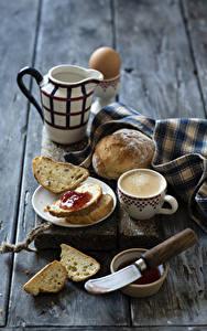 Fotos Kaffee Cappuccino Brot Warenje Messer Bretter Frühstück Kanne Tasse