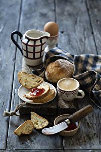 Fotos Kaffee Cappuccino Brot Warenje Messer Bretter Frühstück Kanne Tasse Lebensmittel
