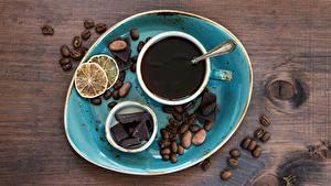 Fotos Kaffee Schokolade Schalenobst Zitrone Bretter Tasse Getreide Lebensmittel